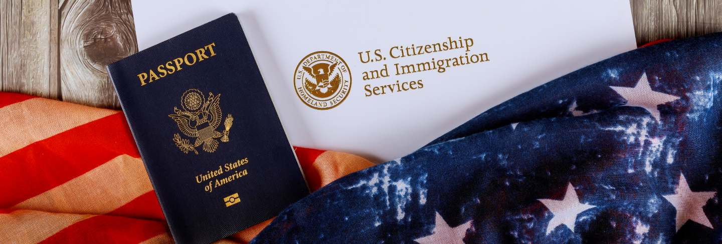 Usa passport and certificate of naturalization of citizenship us flag over wooden table